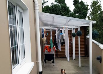 Outdoor area covered by an outdoor canopy